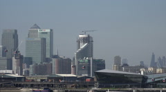 Canary Wharf skyline from Royal Victoria Dock, London, zoom out Stock Footage
