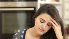Depressed woman at home, close up, dolly shot. - stock footage