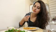 Beautiful woman eating pasta at home. Stock Footage