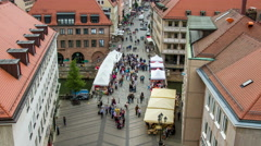 Street with bridge and market, crowded people timelapse Stock Footage