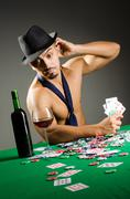 Man drinking and playing in casino - stock photo