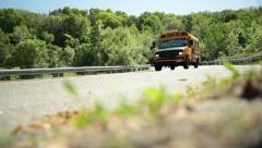 Yellow School Bus gets on highway traffic on ramp Stock Footage