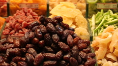 Image of market offering a selection of dried fruits - stock footage