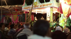 Dancing crowd in Indian music festival, long shot, pan right Arkistovideo