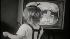 2144 children watch television at home in the 1950's - vintage film home movie Stock Footage