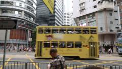 Old double-decker trams on the Wan Chai Road in Hong Kong - stock footage
