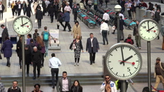 Business people, clock, time is money, London financial district, England Stock Footage
