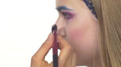 Eye make-up woman applying eyeshadow, making exotic, one, blue eyebrow, blusher Stock Footage