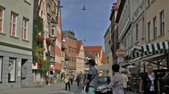 Pedestrians strolling, shopping and visiting in a street scene in Ulm, Germany Stock Footage