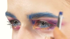 Eye make-up woman applying eyeshadow, making exotic, one, blue eyebrow, yellow - stock footage