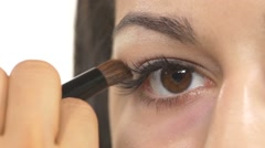 Stock Video Footage of Make-up artist applying a light brown shadows, close up