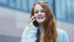 Beautiful, attractive woman talking on the phone Stock Footage