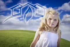 Adorable Blue Eyed Girl Playing Outside with Ghosted Green House Graphic Stock Photos