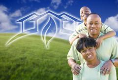 Happy African American Family and Green House Graphic in Grass Field. Stock Photos