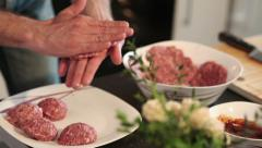 Chef making burgers in kitchen with ground beef - stock footage