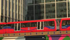 Zoom in, Docklands light railway, Canary Wharf, London, England Stock Footage