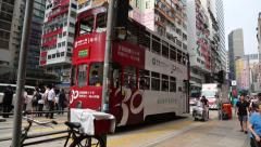 Old double-decker trams on the Johnston Road, Hong Kong Stock Footage