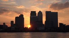 Stock Video Footage of Canary Wharf skyline at sunset, London, England