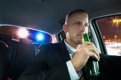 Young Man Drinking Beer And Pulled Over By Police - stock photo
