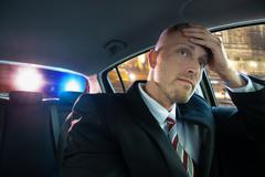 Stressed Young Driver Has Problems With Police - stock photo