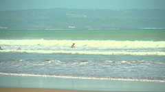 Surfers Catching Waves Stock Footage