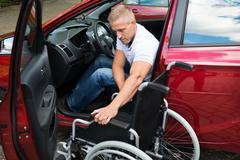Portrait Of A Handicapped Car Driver With A Wheelchair Stock Photos