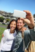 Couple fun taking self-portrait selfie in San Francisco with smart phone Stock Photos