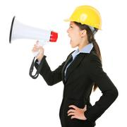 Megaphone screaming engineer contractor woman Stock Photos