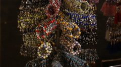 Selling jewelry bracelets with Nazar amulet on the market in Istanbul Stock Footage
