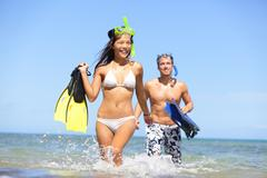 Happy couple beach summer vacation travel fun Stock Photos