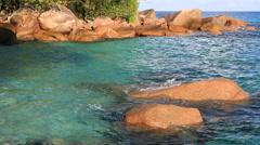 Beautiful granite boulders in Indian Ocean on the beach of Anse Lazio Stock Footage