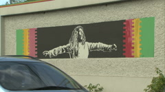 6210 mural on wall outside of Bob Marley Museum, Kingston Stock Footage