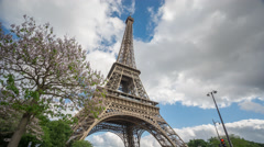The Eiffel Tower in Paris time lapse from bottom Stock Footage