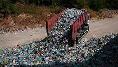 Truck unloads sorted plastic bottles. - stock footage