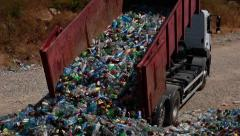 Truck unloads sorted plastic bottles. Waste recycling. Stock Footage