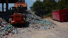 Bulldozer packs up sorted waste for recycling. Stock Footage