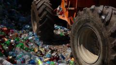 Bulldozer packs up waste for recycling. Stock Footage