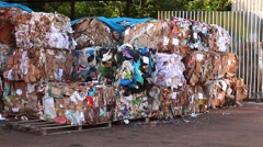 Sorted and packaged garbage. Recycling of cardboard and polyethylene. - stock footage