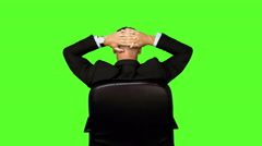 Businessman sitting in swivel chair Stock Footage