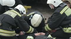 SEVASTOPOL,CRIMEA/RUSSIA: Rescuers applying bandage on broken leg, firemen Stock Footage