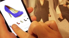 A woman buys a high-heeled shoes in the online store. Stock Footage