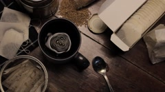 Tea packet and coffee cup - stock footage