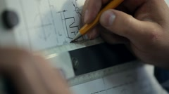 Man Draws a Technical Drawing on Drawing Board - stock footage