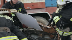 SEVASTOPOL,CRIMEA/RUSSIA-Rescuers with Hydraulic rescue tools: cutter/spreader Stock Footage