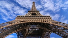 The Eiffel Tower in Paris France with the clouds on the background. Arkistovideo