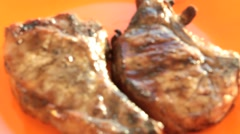 Char grilled steak on a plate Stock Footage