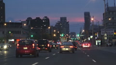 Driving in the city at night early evening Stock Footage