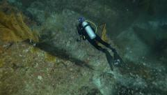 Scuba diver from above bubbles Stock Footage