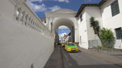 Driving under the Arco de la Reina in Quito, Ecuador Stock Footage