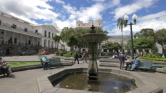 Sitting on benches in the Independence Square in Quito - stock footage